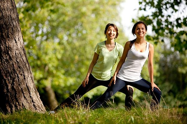 Beautiful women stretching at the park - fitness concepts