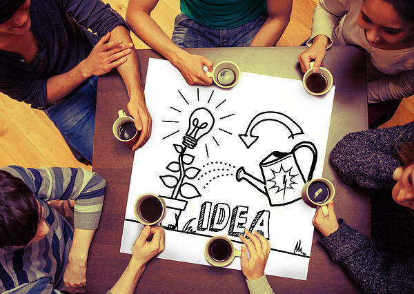 Composite image of idea and innovation graphic on page with people sitting around table drinking coffee-1