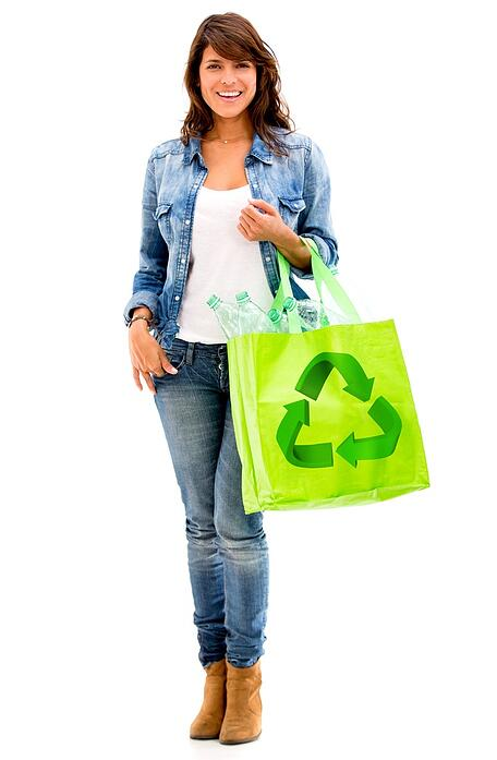 Ecological woman with a green bag - isolated over white