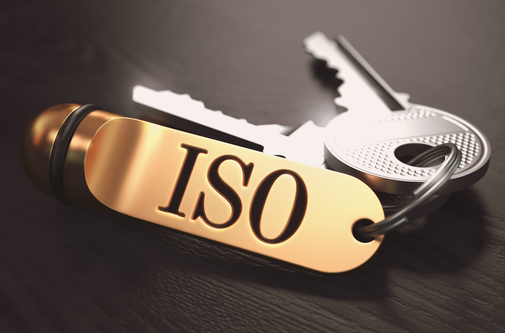 ISO - International Organization for Standardization - Concept. Keys with Golden Keyring on Black Wooden Table. Closeup View, Selective Focus, 3D Render. Toned Image.